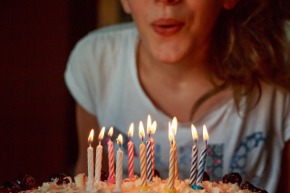 girl with birthday candles