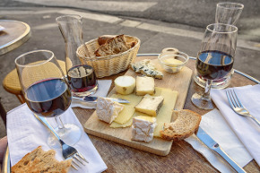 wine and cheese on table