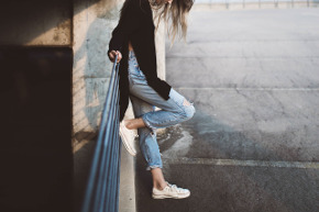 girl wearing white sneakers